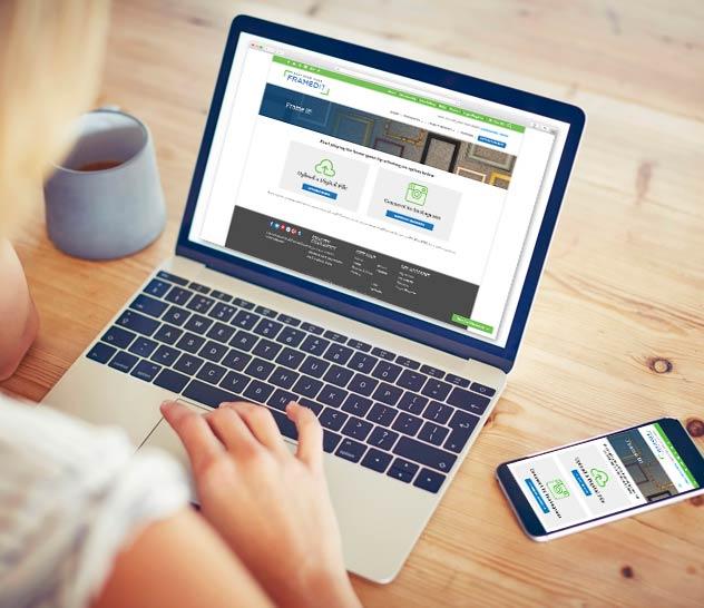 laptop and mobile phone displaying FramedIt web interface